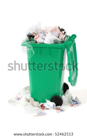 overflowing garbage bin - stock photo