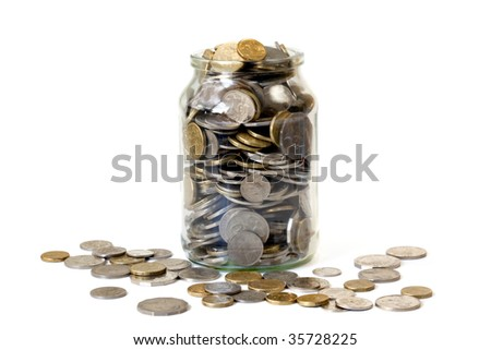 Overflowing jar of Australian coins, isolated on white. - stock photo