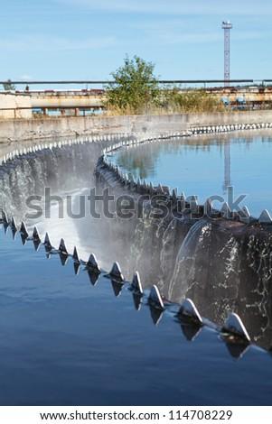 Overflowing sewage from radial sedimentation tank - stock photo