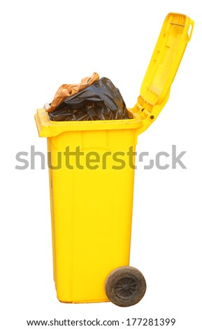 Overflowing yellow recycling bin on white background, clipping path. - stock photo