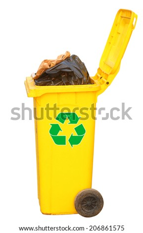 Overflowing yellow recycling bin with green logo, clipping path. - stock photo