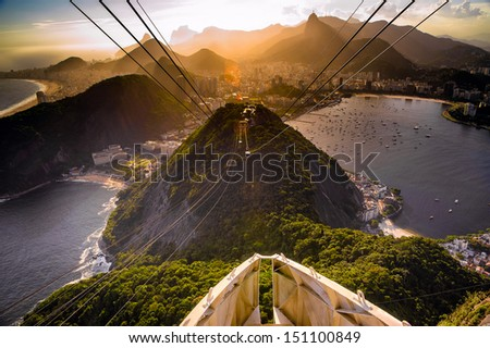 Overhead cable car approaching Sugarloaf Mountain, Rio De Janeiro, Brazil - stock photo