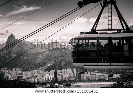 Overhead cable car moving over a city, Rio De Janeiro, Brazil - stock photo