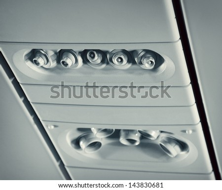 Overhead console in aircraft - stock photo