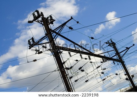 Overhead electric powers lines on the New Jersey railway system. - stock photo