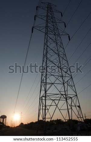 Overhead electricity wires and sunset perspective - stock photo