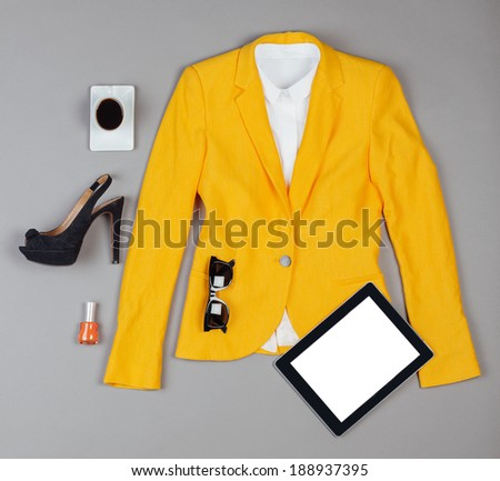 Overhead of clothes and woman accessories. / Outfit of essentials business woman on grey background. - stock photo