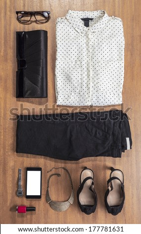 Overhead of essentials elegant woman./ Outfit of business woman on wood background.