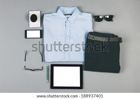 Overhead of essentials modern man./ Outfit of business man on grey background.  - stock photo