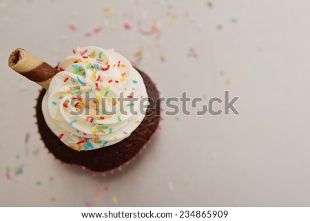 Overhead of sprinkles on cupcake with clear space - stock photo