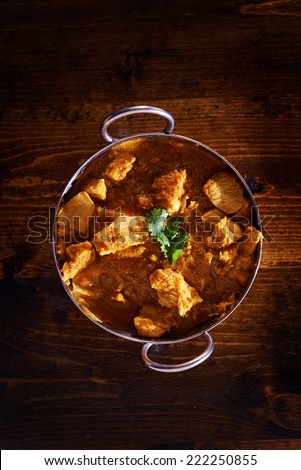 overhead photo of a batli dish with indian butter chicken curry - stock photo