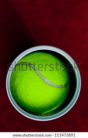 Overhead shot from a tennis ball in a can. - stock photo