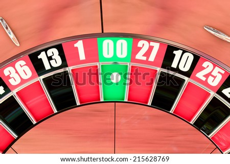 Overhead shot of an American roulette wheel winning number double zero - stock photo