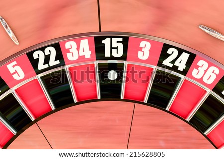 Overhead shot of an American roulette wheel winning number fifteen - stock photo