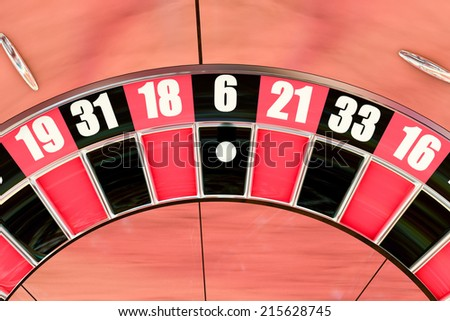 Overhead shot of an American roulette wheel winning number six - stock photo