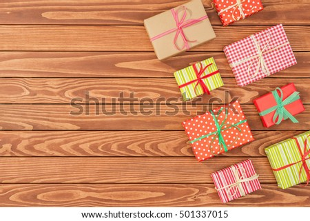 Overhead shot of christmas presents on wooden table