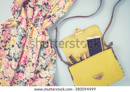 Overhead shot of female dress and bag - stock photo