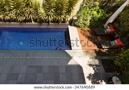 Overhead view of a backyard swimming pool and garden in a contemporary home - stock photo