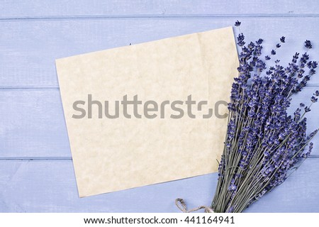Overhead view of a bundle of dried lavender flowers with an old piece of paper with copy space.