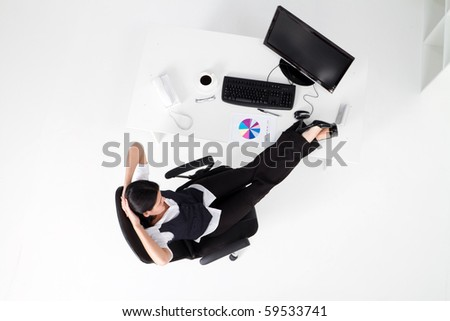 overhead view of a businesswoman relaxing in office - stock photo