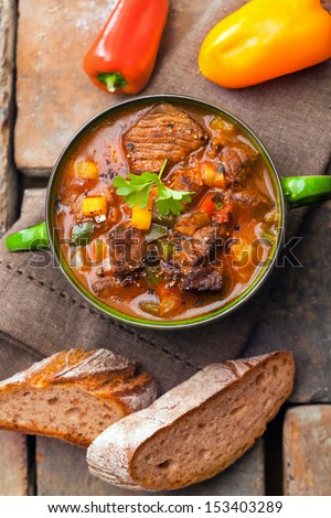 Overhead view of a delicious winter meat casserole or stew with thick rich gravy and vegetables for a healthy nourishing meal - stock photo