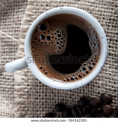 Overhead view of a freshly brewed mug of  black  coffee - stock photo