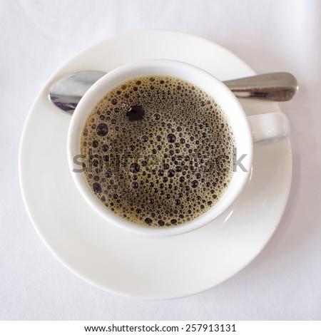Overhead view of a freshly brewed mug of black coffee - stock photo