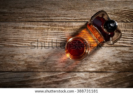 overhead view of a glass and bottle of whiskey - stock photo