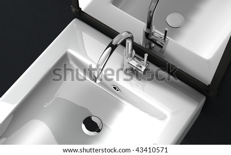 overhead view  of a high spout faucet in front of a mirror