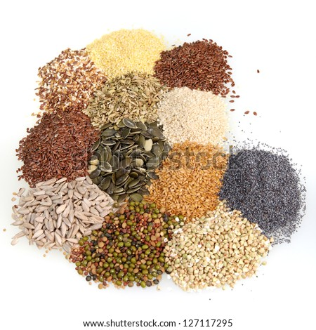 Overhead view of a large assortment of edible raw seeds including shelled and whole sunflower, poppy, legumes, sesame and linseed used as a seasoning and ingredient in cooking or for their oil content