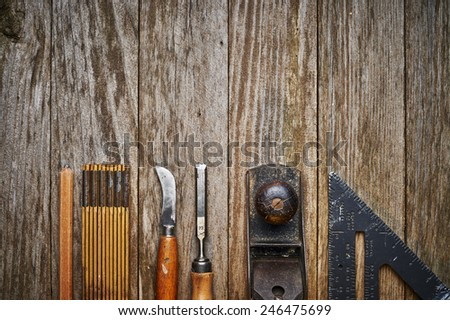 overhead view of a set of old wood working tools - stock photo