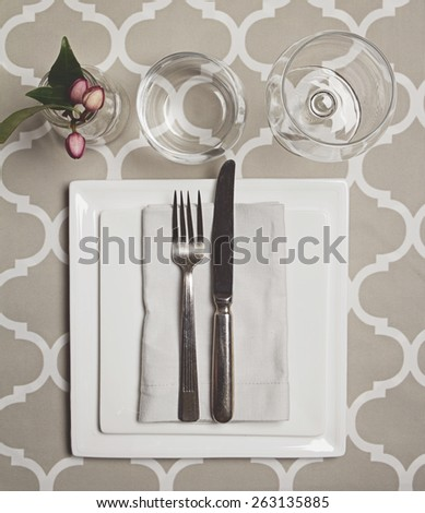 Overhead view of a simple moroccan fine dining table setting - stock photo
