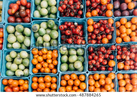 Overhead view of a tray of heirloom cherry tomatoes