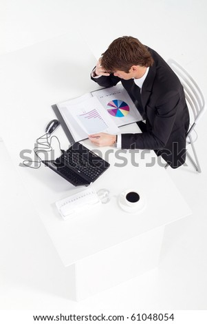 overhead view of a young businessman working in office - stock photo