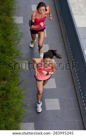 overhead view of active sporty women training outdoors for marathon run in morning - stock photo