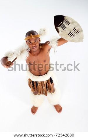 overhead view of african tribal man in studio - stock photo