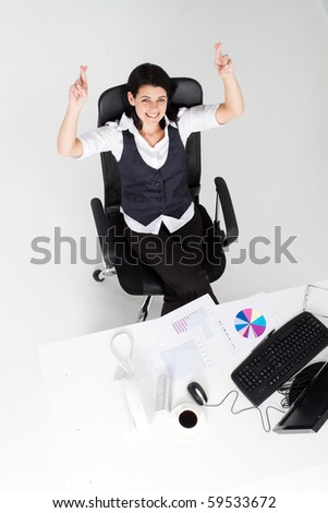 overhead view of beautiful businesswoman crossing finger for good luck - stock photo