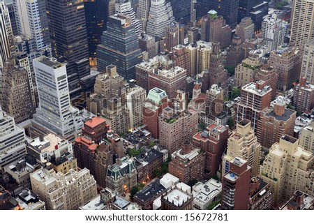 Overhead view of buildings in Midtown Manhattan in New York City in early morning light.