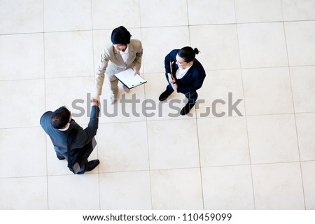 overhead view of business meeting - stock photo