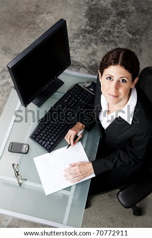 overhead view of businesswoman in an office - stock photo