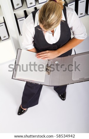 overhead view of businesswoman looking at files - stock photo
