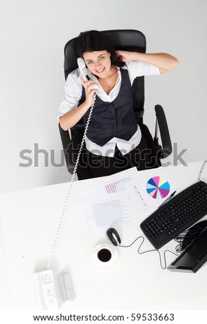 overhead view of businesswoman talking on telephone in office