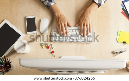 Overhead View Of Businesswoman Working At Computer In Her Table - stock photo