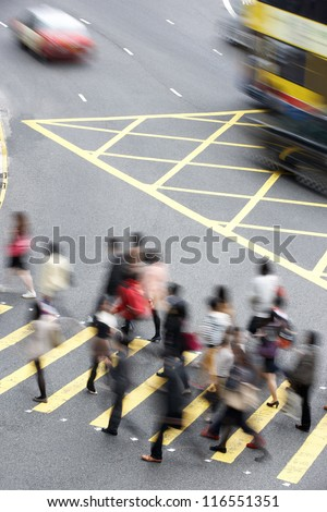 Overhead View Of Commuters Crossing Busy Hong Kong Street - stock photo