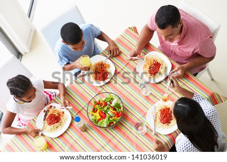 Overhead View Of Family Eating Meal Together - stock photo
