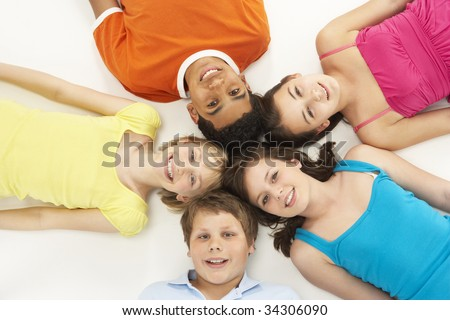 Overhead View Of Five Young Children In Studio - stock photo
