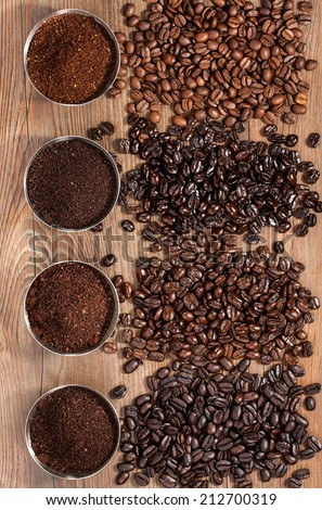 Overhead view of four varieties of fresh roasted coffee Beans - stock photo