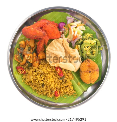Overhead view of full length Indian biryani rice isolated on white background. - stock photo