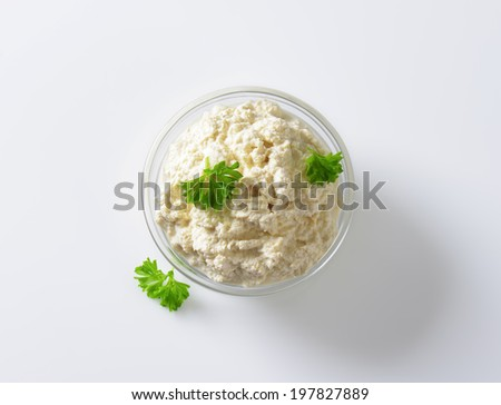 overhead view of glass bowl with smooth cheese spread - stock photo