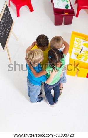 overhead view of group of preschool kids hugging - stock photo